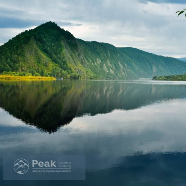 Peak Coaching Academy Logo - image of a lake and mountain.