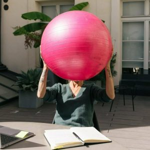 Office Worker holding a Yoga Ball